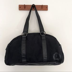 Agnes B sport leather and canvas gym bag